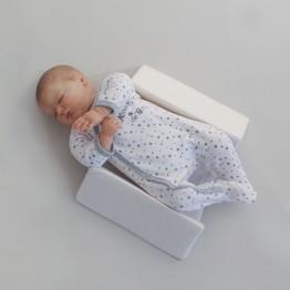 Cale bébé latéral et dorsal